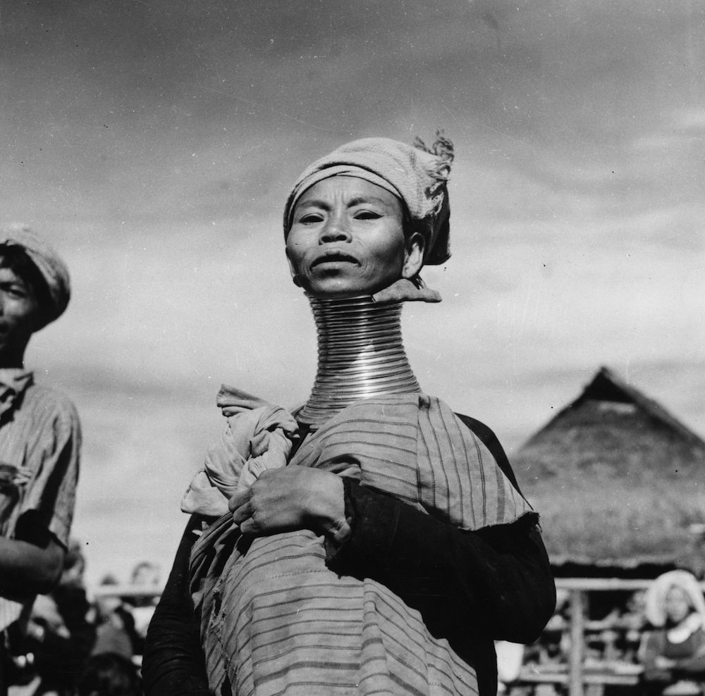 circa 1950: A Padaung, or Kayan woman. Originally a Mongolian tribe, the Padaung have been assimilated into the Karen group native to Mayanmar (Burma). The most stiking feature of these people are the brass rings fitted to the necks and limbs of women born on Wednesdays. The first neck ring is fitted when they are five or six, with successive rings fitted every two years, denoting the status of their family. (Photo by Vitold de Golish/Three Lions/Getty Images)